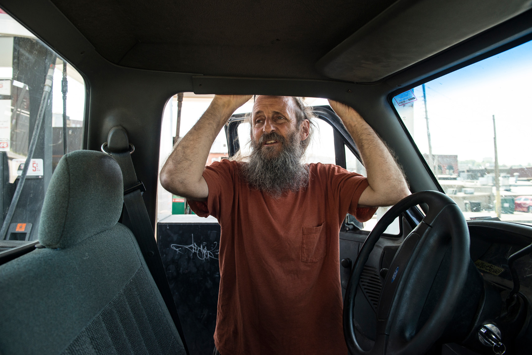 Adam Jones, bearded man with truck portrait